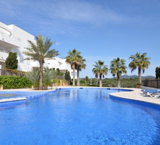 Ground floor apartment with pool and gardens for sale in Cala d´Or