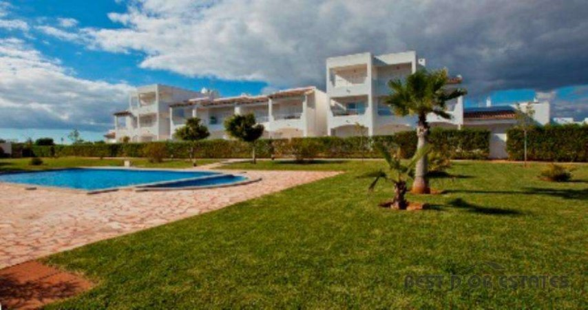 Apartment with communal pool and gardens for sale near the beach of Cala Egos
