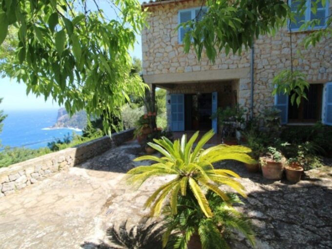 Sea view stone house with traditional features for sale in Deia